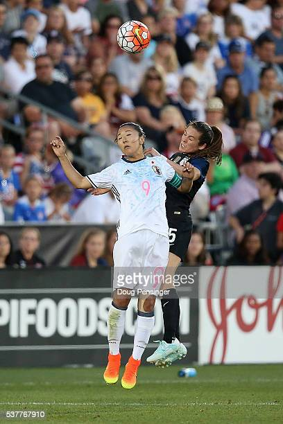 Yuki Ogimi of Japan and Kelley O'Hara of United States of America vie for a head ball during an international friendly match at Dick's Sporting Goods...