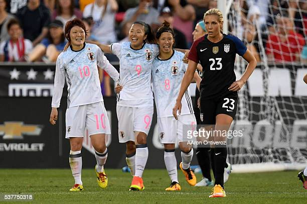 Yuki Ogimi of Japan celebrates her goal against the US Women's National Team with teammates Mizuho Sakaguchi and Sonoko Chiba as Allie Long reacts...
