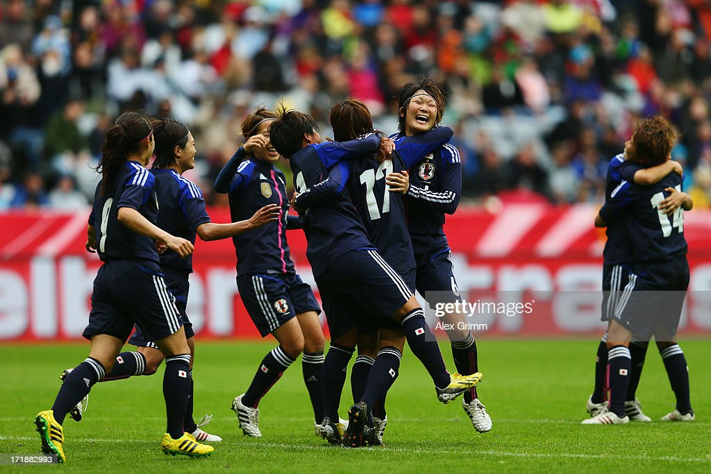 <a gi-track='captionPersonalityLinkClicked' href=/galleries/search?phrase=Yuki+Ogimi&family=editorial&specificpeople=9532711 ng-click='$event.stopPropagation()'>Yuki Ogimi</a> of Japan celebrates her team's second goal with team mates during the Women's International Friendly match between Germany and Japan at Allianz Arena on June 29, 2013 in Munich, Germany.