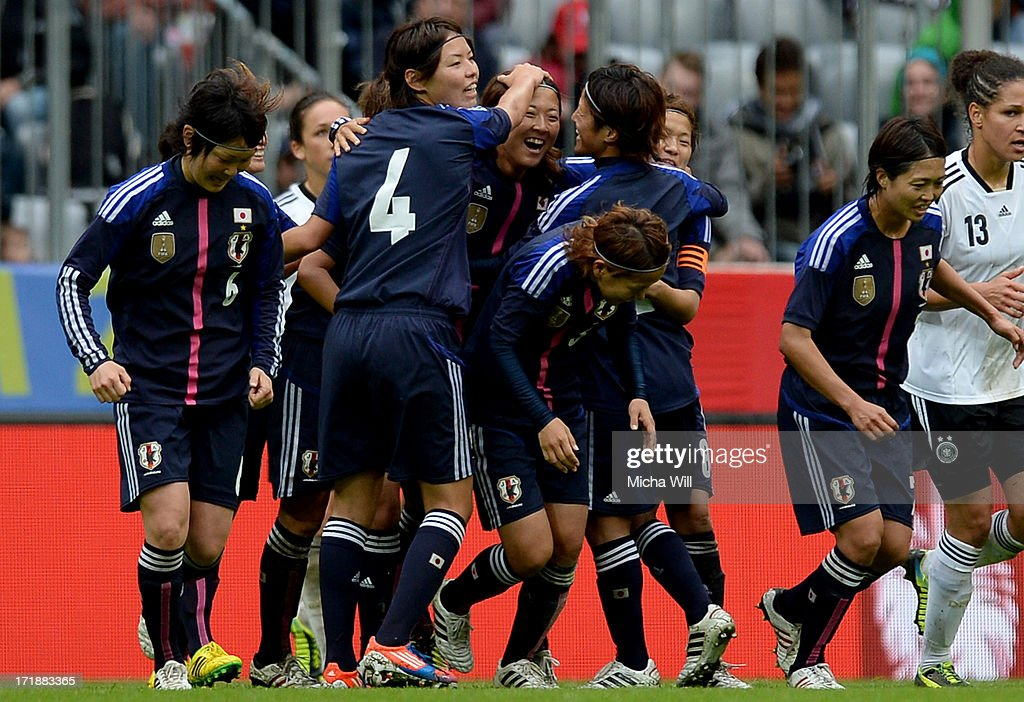 Yuki Ogimi (C) of Japan celebrates with team mates after scoring her team's second goal during the Women's International Friendly match between Germany and Japan at Allianz Arena on June 29, 2013 in Munich, Germany.