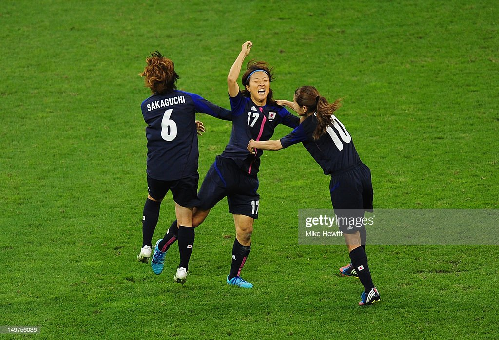 Yuki Ogimi of Japan celebrates with team mates Mizuho Sakaguchi #6 and Homare Sawa of Japanscoring the opening goal during the Women's Football Quarter Final match between Brazil and Japan, on Day 7 of the London 2012 Olympic Games at Millennium Stadium on August 3, 2012 in Cardiff, Wales.
