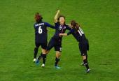 Yuki Ogimi of Japan celebrates with team mates Mizuho Sakaguchi and Homare Sawa of Japanscoring the opening goal during the Women's Football Quarter...