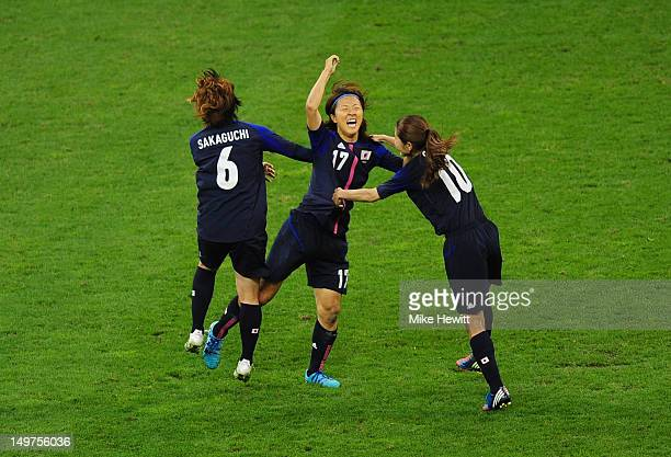 Yuki Ogimi of Japan celebrates with team mates Mizuho Sakaguchi and Homare Sawa of Japanscoring the opening goal during the Women's Football Quarter...