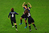 Yuki Ogimi of Japan celebrates with team mates Mizuho Sakaguchi and Homare Sawa of Japan after scoring the opening goal during the Women's Football...