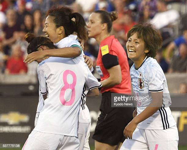 Yuki Ogimi of Japan celebrates with teammates after scoring her team's second goal of the first half against the United States in an international...