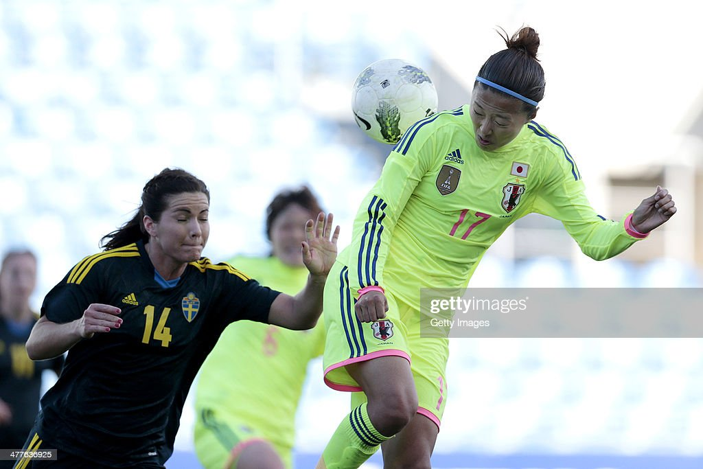 Yuki Ogimi of Japan challenges Hanna Folkesson of Sweden during the Algarve Cup 2014 match between Japan and Sweden on March 10, 2014 in Loule, Portugal.