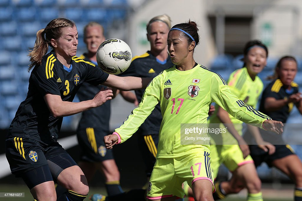 Yuki Ogimi of Japan challenges LInda Sembrant of Sweden during the Algarve Cup 2014 match between Japan and Sweden on March 10, 2014 in Loule, Portugal.