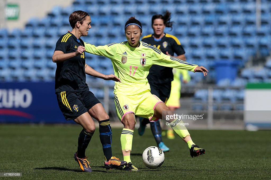 Yuki Ogimi of Japan challenges Therese Sjogran of Sweden during the Algarve Cup 2014 match between Japan and Sweden on March 10, 2014 in Loule, Portugal.