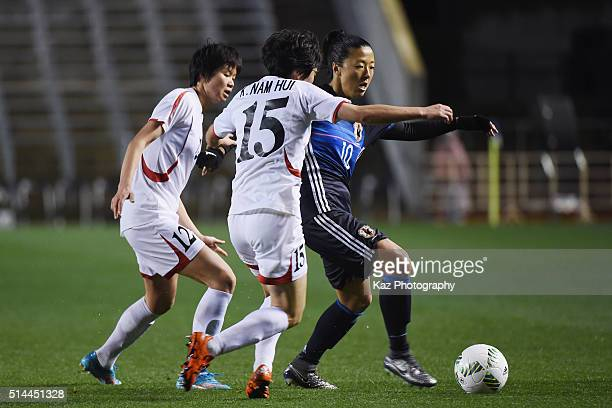 Yuki Ogimi of Japan competes for the ball against Kim Yun Mi and Kim Nam Hui of North Korea during the AFC Women's Olympic Final Qualification Round...