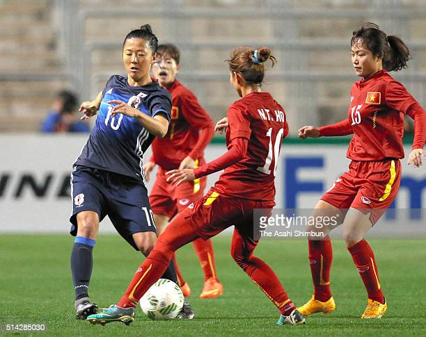 Yuki Ogimi of Japan competes for the ball against Nguyen Thi Hoa and Do Thi Yen of Vietnam during the AFC Women's Olympic Final Qualification Round...