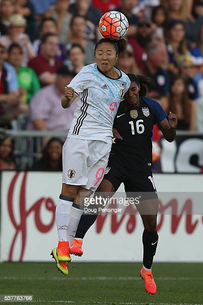 Yuki Ogimi of Japan heads the ball away from Crystal Dunn of United States of America during an international friendly match at Dick's Sporting Goods...