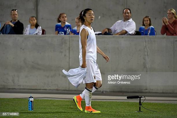 Yuki Ogimi of Japan reacts to receiving a red card as she walks off the pitch against the US Women's National Team during the second half of their 33...