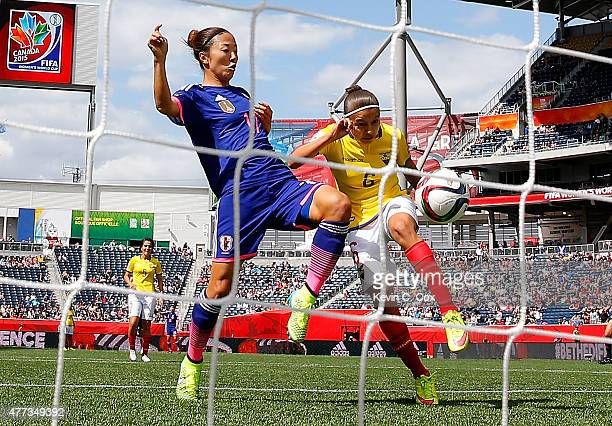 Yuki Ogimi of Japan scores the first goal against Angie Ponce of Ecuador during the FIFA Women's World Cup Canada 2015 Group C match between Ecuador...