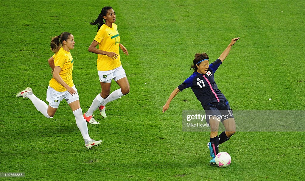 <a gi-track='captionPersonalityLinkClicked' href=/galleries/search?phrase=Yuki+Ogimi&family=editorial&specificpeople=9532711 ng-click='$event.stopPropagation()'>Yuki Ogimi</a> of Japan scores the opening goal despite the efforts of Erika (L) and Bruna of Brazil during the Women's Football Quarter Final match between Brazil and Japan, on Day 7 of the London 2012 Olympic Games at Millennium Stadium on August 3, 2012 in Cardiff, Wales.