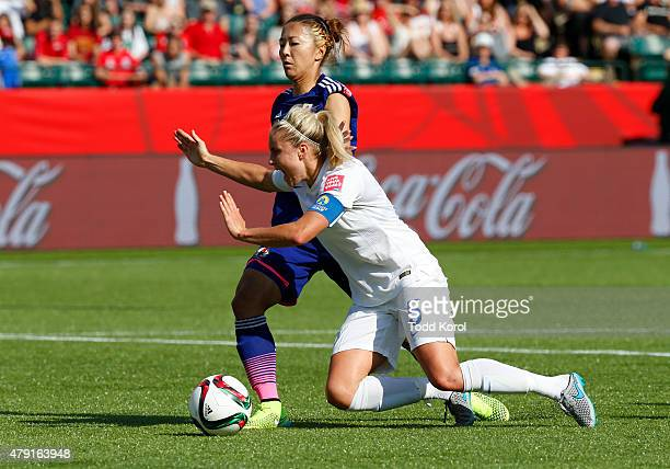 Yuki Ogimi of Japan trips up Steph Houghton of England resulting in a penalty shot and a goal for England during the FIFA Women's World Cup Canada...