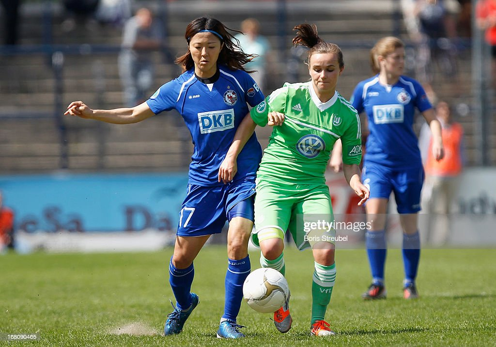 Yuki Ogimi of Potsdam (L) battles for the ball with Lina Magull of Wolfsburg during the Women's Bundesliga match between 1. FFC Turbine Potsdam and VfL Wolfsburg on May 5, 2013 in Potsdam, Germany.