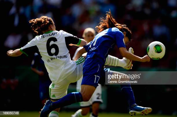 Yuki Ogimi of Potsdam goes for a header under the pressure of Maren Tetzlaff of Wolfsburg during the Women's DFB Cup Final between VfL Wolfsburg and...