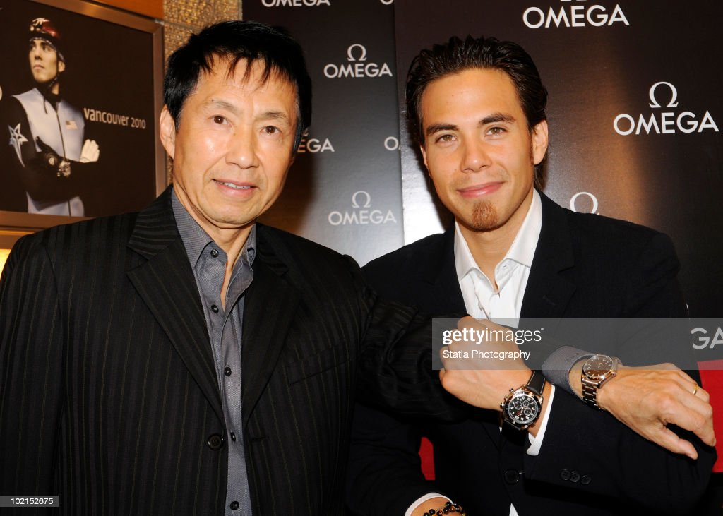 Yuki Ohno (L) and Apolo Ohno attend the OMEGA hosted father's day appearance at Omega Flagship Boutique on June 16, 2010 in New York City.