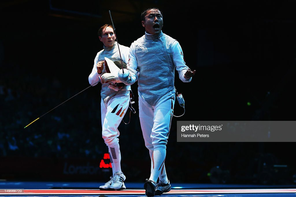 <a gi-track='captionPersonalityLinkClicked' href=/galleries/search?phrase=Yuki+Ota&family=editorial&specificpeople=2956051 ng-click='$event.stopPropagation()'>Yuki Ota</a> of Japan celebrates after beating <a gi-track='captionPersonalityLinkClicked' href=/galleries/search?phrase=Benjamin+Kleibrink&family=editorial&specificpeople=2203993 ng-click='$event.stopPropagation()'>Benjamin Kleibrink</a> of Germany during the round of 32 Men's Foil Individual on Day 4 of the London 2012 Olympic Games at ExCeL on July 31, 2012 in London, England.