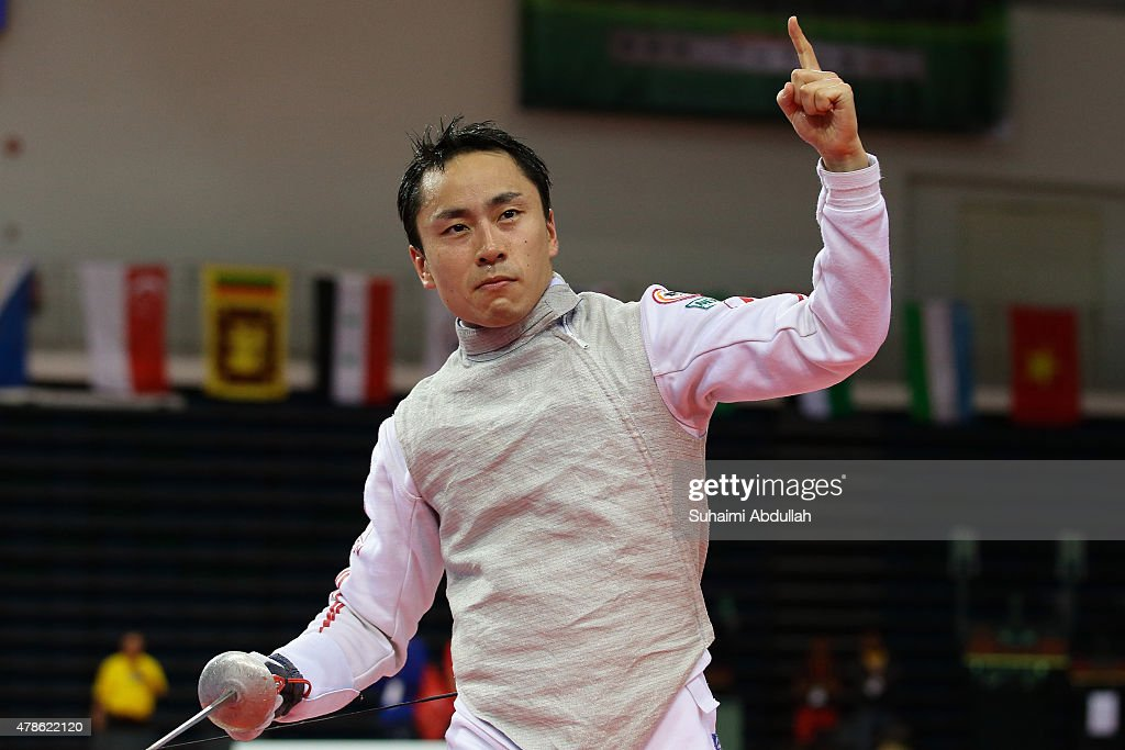 <a gi-track='captionPersonalityLinkClicked' href=/galleries/search?phrase=Yuki+Ota&family=editorial&specificpeople=2956051 ng-click='$event.stopPropagation()'>Yuki Ota</a> of Japan celebrates victory over Son Young Ki of South Korea in the men's individual foil final during the 2015 Asian Fencing Championships at OCBC Arena on June 26, 2015 in Singapore.