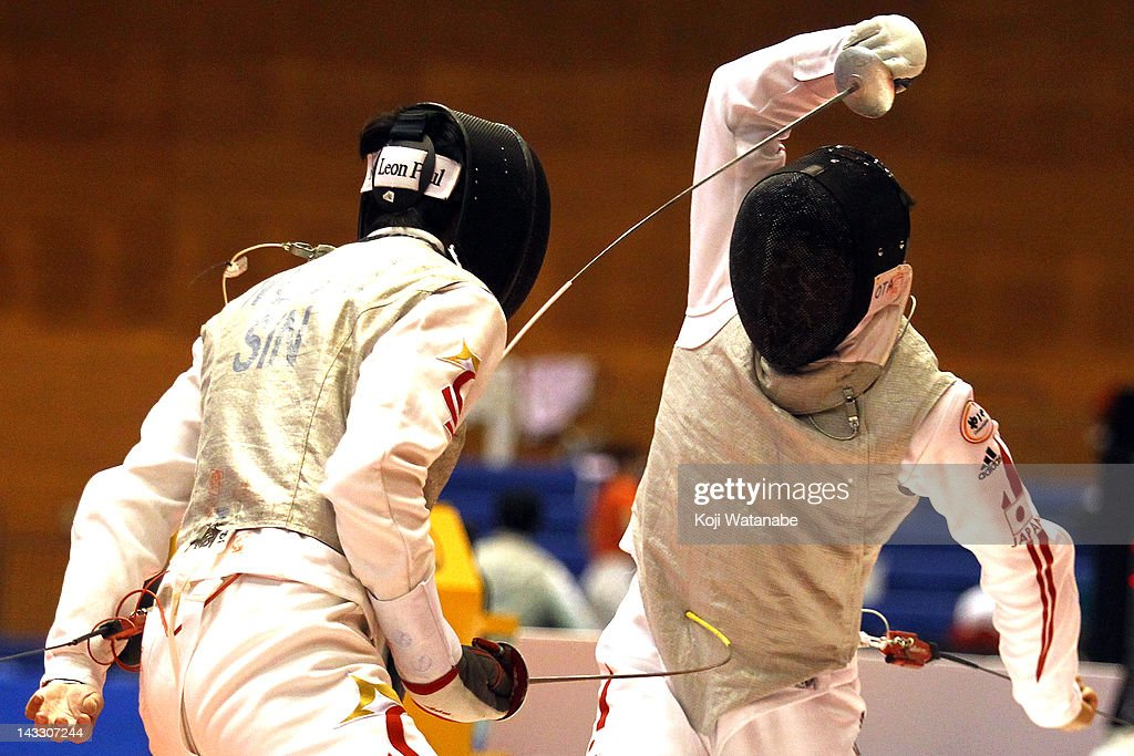 Yuki Ota of Japan competes against Wu Jie of Singapore in the Men's Foil individual tableau of 16 on day two of the 2012 Asian Fencing Championships at Wakayama Big Wave on April 23, 2012 in Wakayama, Japan.