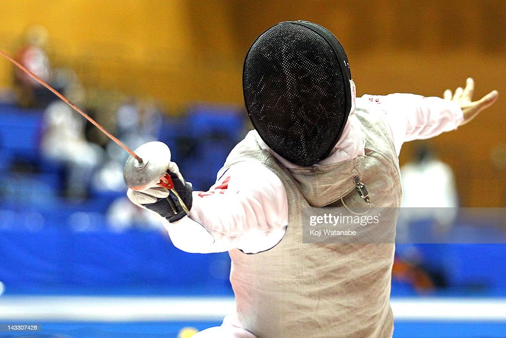<a gi-track='captionPersonalityLinkClicked' href=/galleries/search?phrase=Yuki+Ota&family=editorial&specificpeople=2956051 ng-click='$event.stopPropagation()'>Yuki Ota</a> of Japan in action during in the Men's Foil individual tableau of 16 on day two of the 2012 Asian Fencing Championships at Wakayama Big Wave on April 23, 2012 in Wakayama, Japan.