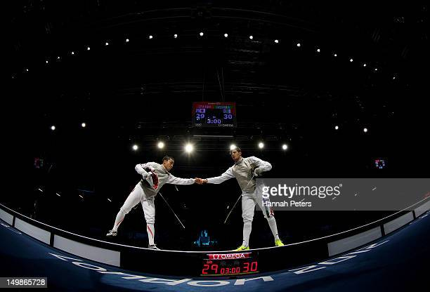Yuki Ota of Japan shakes hands with Andrea Cassara of Italy in the gold medal match in the Men's Foil Team Fencing finals on Day 9 of the London 2012...