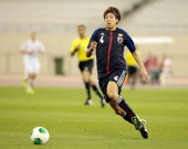 Yuki Otsu of Japan controls the ball during the international friendly match between Japan and Canada at Khalifa International Stadium on March 22...