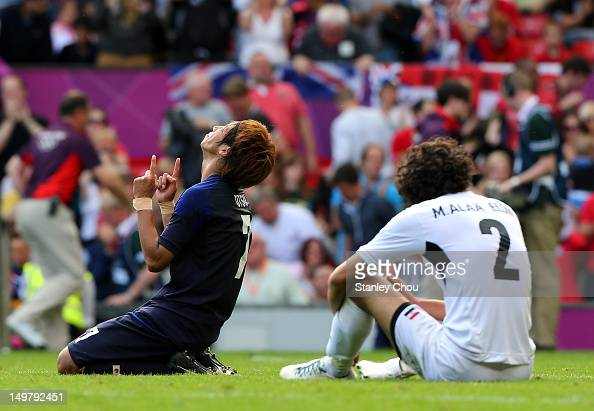 Yuki Otsu of Japan reacts after the final whistle while Alaa Eldin Mahmoud of Egypt is dejected during the Men's Football Quarter Final match between...