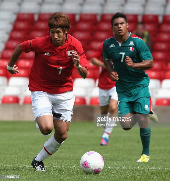 Yuki Otsu of Japan runs with the ball during the friendly international match between Japan and Mexico at the City Ground on July 21 2012 in...