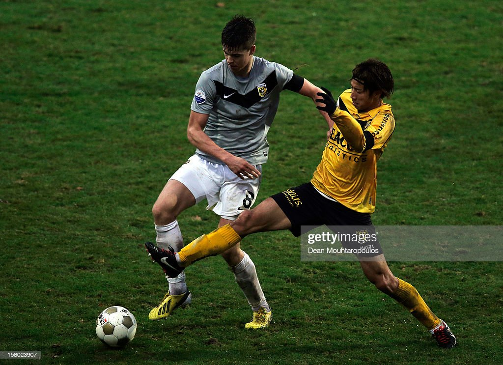 Yuki Otsu of Venlo and Marco van Ginkel of Vitesse battle for the ball during the Eredivisie match between VVV Venlo and Vitesse Arnhem at the Seacon Stadion De Koel on December 9, 2012 in Venlo, Netherlands.