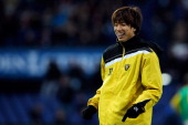 Yuki Otsu of Venlo has a laugh with team mates as he warms up prior to the Eredivisie match between Feyenoord and VVV Venlo at De Kuip on April 5...