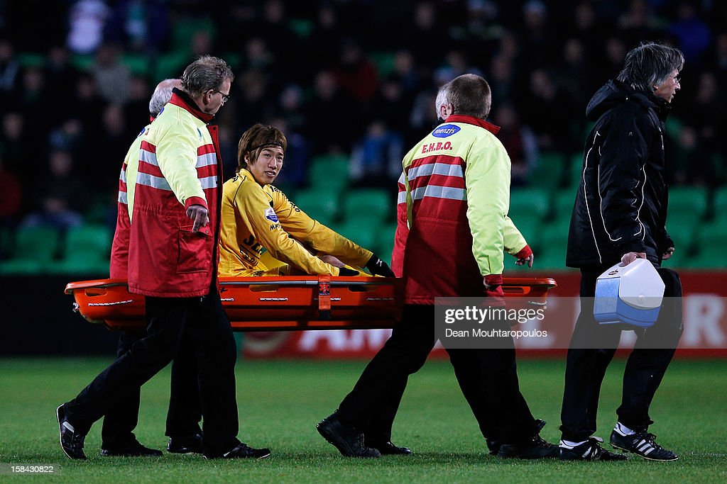 Yuki Otsu of Venlo is carried off with a stretcher by medical staff during the Eredivisie match between FC Groningen and VVV Venlo at the Euroborg Stadium on December 15, 2012 in Groningen, Netherlands.
