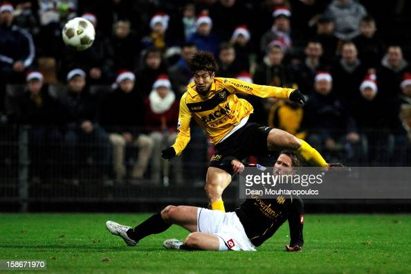 Yuki Otsu of Venlo shoots on goal as Laurent Delorge of Roda JC attempts the tackle during the Eredivisie match between VVV Venlo and Roda JC...