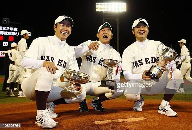 Yuki Saito Yuya Fukui and Tatsuya Oishi of Waseda University pose for photographs with the trophies after the Tokyo Big 6 University Baseball Autumn...
