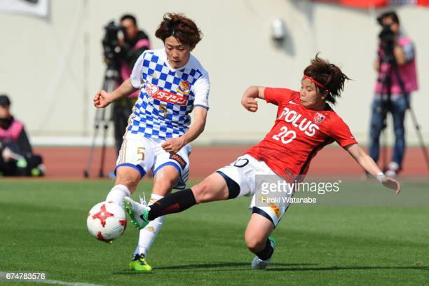 yuki Sakai of Mynavi Vegalta Sendai Ladies and Chika Kato of Urawa Red Diamonds Ladies compete for the ball during the Nadeshiko League match between...