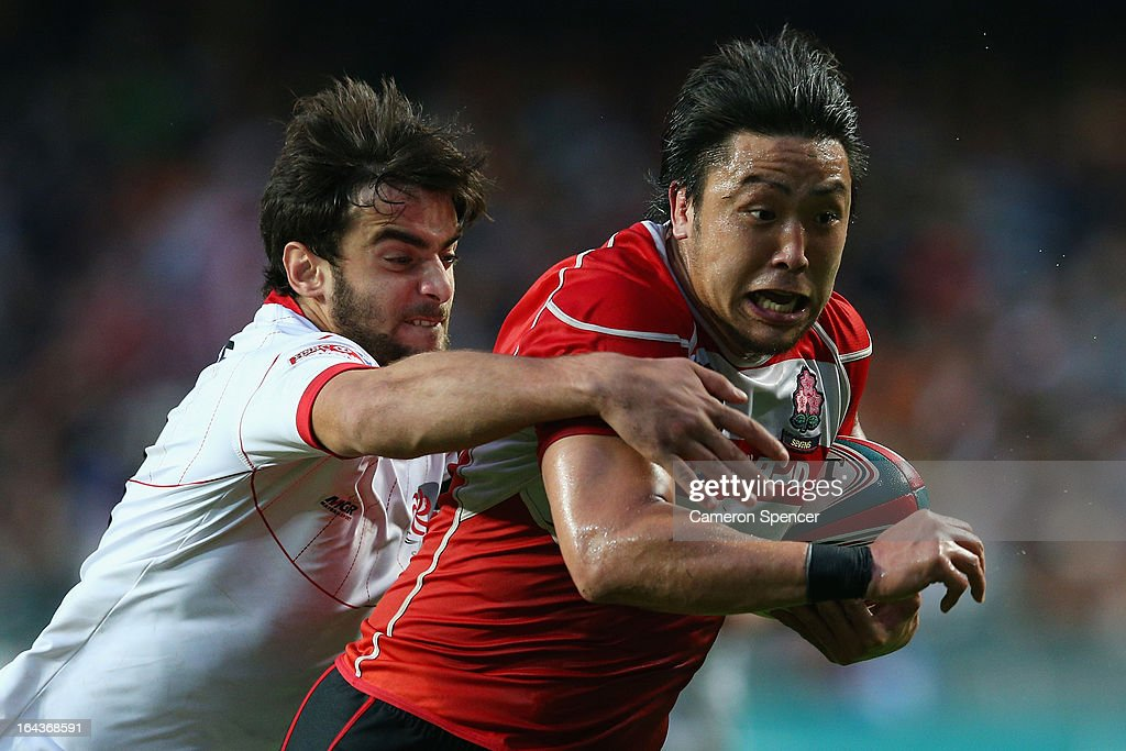 Yuki Shishimoto of Japan is tackled during the match between Georgia and Japan during day two of the 2013 Hong Kong Sevens at Hong Kong Stadium on March 23, 2013 in So Kon Po, Hong Kong.