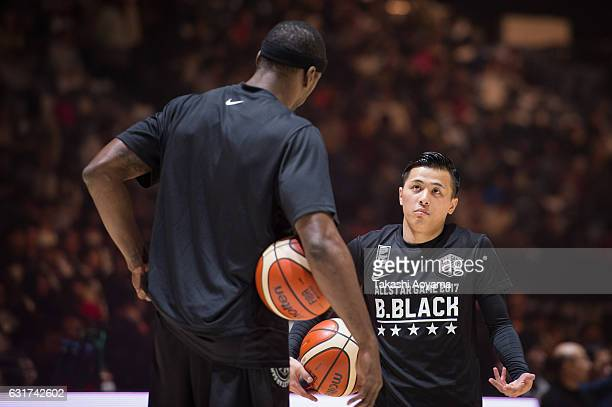 Yuki Togashi of the BBlack talks with teammate Justin Burrell prior to the B league Allstar Game match between B Black and B White as part of the...
