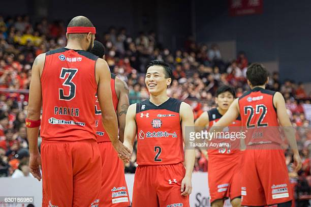 Yuki Togashi of the Chiba Jets talks with teammate Michael Parker during the B League match between Chiba Jets and Toyama Grouses at the Funabashi...