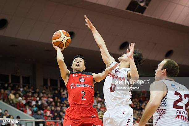 Yuki Togashi of the Chiba Jets tries to shoot under pressure from Yuma Fujii of the Kawasaki Brave Thunders during the B League game between Chiba...