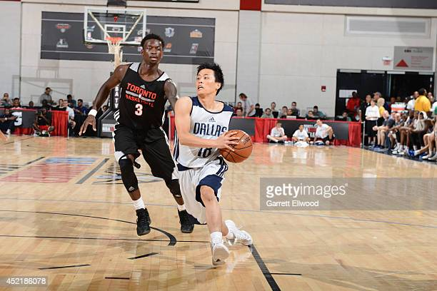 Yuki Togashi of the Dallas Mavericks drives to the basket against Myck Kabongo of the Toronto Raptors during the Samsung NBA Summer League 2014 at...