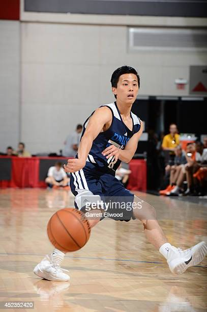 Yuki Togashi of the Dallas Mavericks makes a pass against the Phoenix Suns on July 18 2014 at the Cox Pavilion in Las Vegas Nevada NOTE TO USER User...