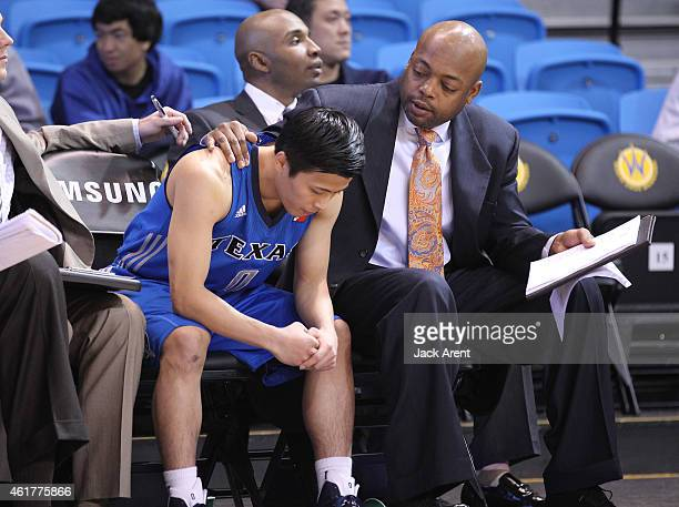 Yuki Togashi of the Texas Legends is consoled by coach Nick Van Exel while playing against the Maine Red Claws of the during the 2015 NBA DLeague...