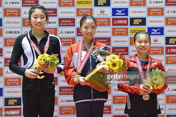 Yuki Uchiyama Asuka Teramoto Aiko Sugihara pose for photographs on the podium during day three of the All Japan Artistic Gymnastics Individual All...
