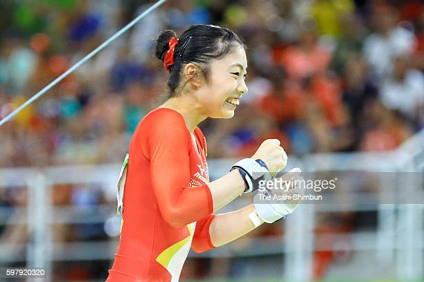 Yuki Uchiyama of Japan celebrates after competing on the uneven bars of the Artistic Gymnastics Women's Team Final on Day 4 of the Rio 2016 Olympic...