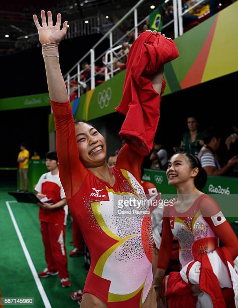 Yuki Uchiyama of Japan waves to fans after competing on the balance beam during Women's qualification for Artistic Gymnastics on Day 2 of the Rio...