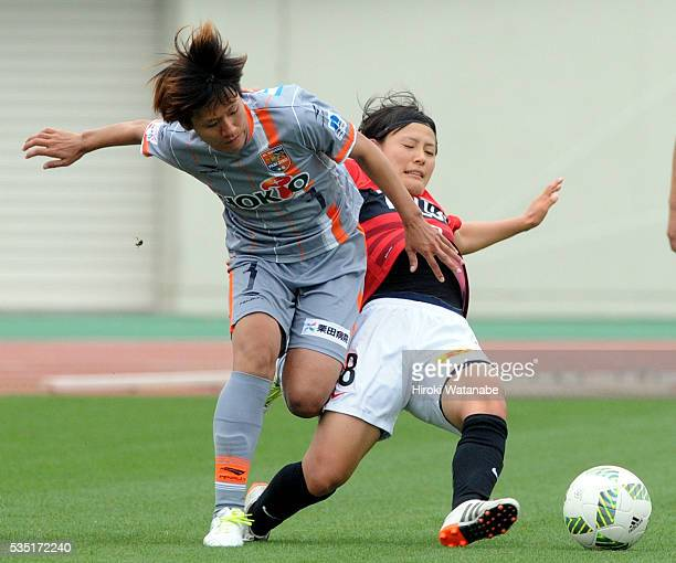 Yuki Yajima of AC Nagano Parceiro is tackled by Hikaru Naomoto of Urawa Reds Ladies during the Nadeshiko League match between Urawa Red Diamonds...
