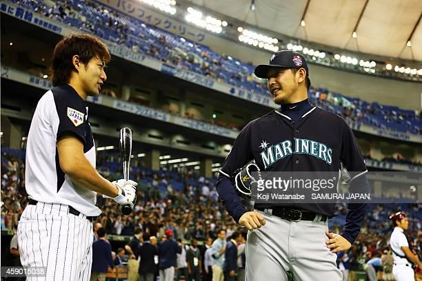 Yuki Yanagita of Samurai Japan and Hisashi Iwakuma of the Seattle Mariners talk during the practice before the game three of Samurai Japan and MLB...