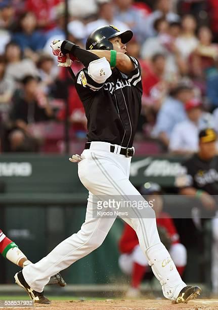 Yuki Yanagita hits a tiebreaking solo home run in the third inning of the SoftBank Hawks' 61 win over the Hiroshima Carp in interleague action at...