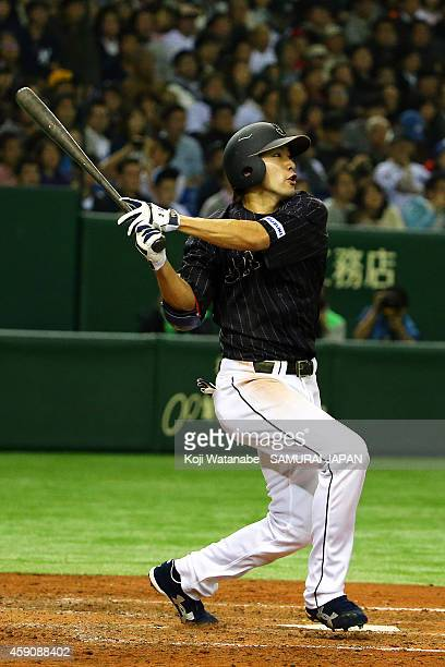 Yuki Yanagita of Samurai Japan hits a double during in the top half of the sixth inning the game four of Samurai Japan and MLB All Stars at Tokyo...